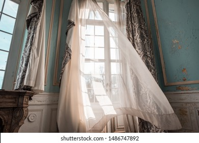 wind blowing through the curtains