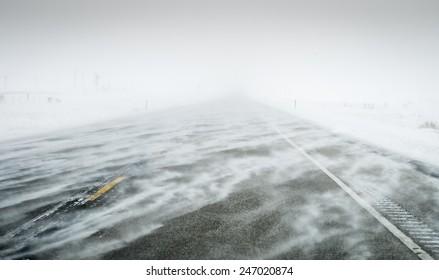 Wind blown snow covered winter roads Colorado