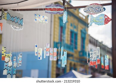 Wind chimes made of fused colored glass in a craft fair in La Boca, Buenos Aires, Argentina