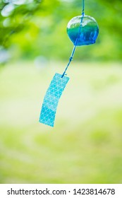 """Wind chimes swaying in the wind. It is a traditional item of Japanese summer called """"Furin""""."""
