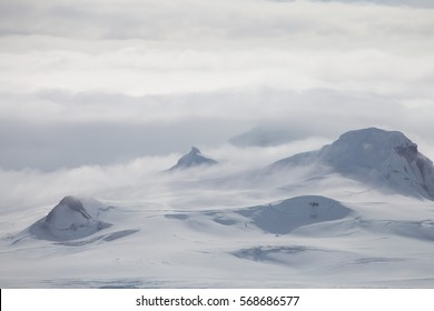 Wind and clouds sweep over this mountain in Antarctica.