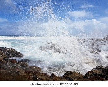 Wind driven waves crashing against a rocky shoreline in the Dominican Republic west of Cabarete.