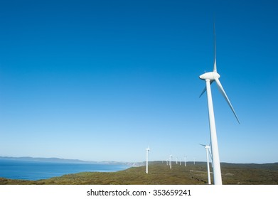 Wind farm along coast of Southern Ocean in Western Australia, supplying clean renewable energy to town of Albany, summer sunny blue sky, copy space.