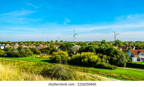 Wind Farm behind the resort community of De Banjaard behind the dunes along the Oosterschelde inlet in the Netherlands