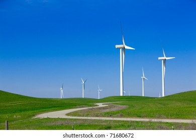 A Wind Farm with blue sky and clouds
