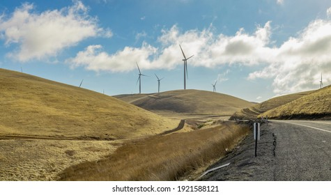 Wind farm in california, on the hills, summer, bright sunny weather with clouds. Concept, pure energy of nature.