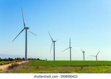 The wind farm consists of several scenic wind turbines. Warm winter in Israel. Gilboa - mountain range in the Jezreel Valley.