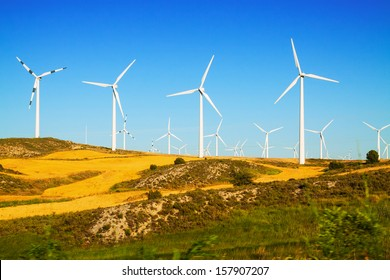 Wind farm at farmland. Aragon, Spain
