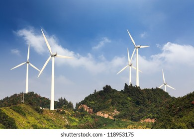wind farm in the hill against a blue sky
