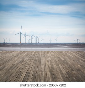 wind farm in mud flat with wooden floor ,develop shoals and renewable energy concept.