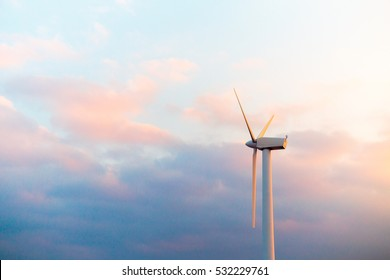wind farm at pink sunset