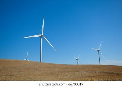 A wind farm in rolling foothills