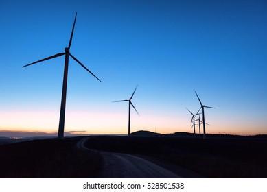 Wind farm silhouette at dusk