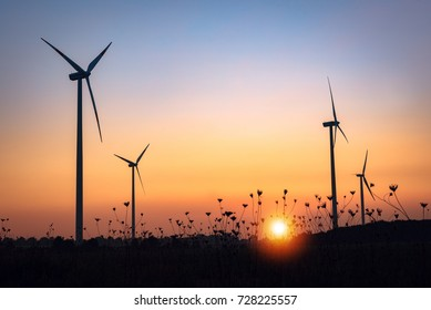 Wind Farm silhouettes at sunset in nature. Germany