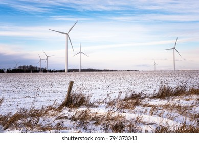 Wind Farm in a Snowy Field in the Countryside of Ontario. Renewable Energy.