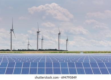 wind farm and solar power station, clean energy against a sunny sky