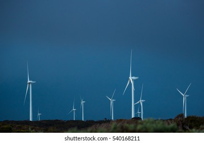 Wind farm with storm clouds in the background