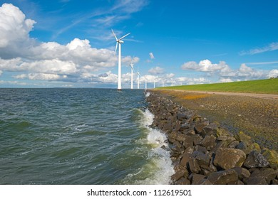 Wind farm in a stormy lake