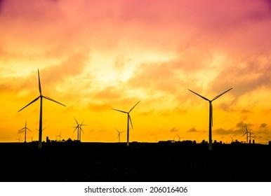 Wind farm at sunset, Alternative energy concept, instagram style retro processing. smart grid