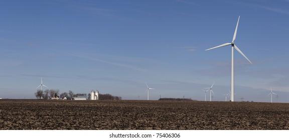 Wind farm at the farm,  turbines for miles in Minnesota.