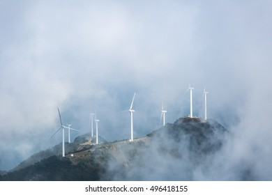 wind farms in the misty clouds on the jiugong mountains ,hubei province,China
