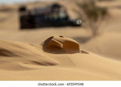 Wind forming the dunes in the western Sahara during a off road trip in Tunisia