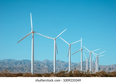 Wind generator against the blue sky and beautiful landscape