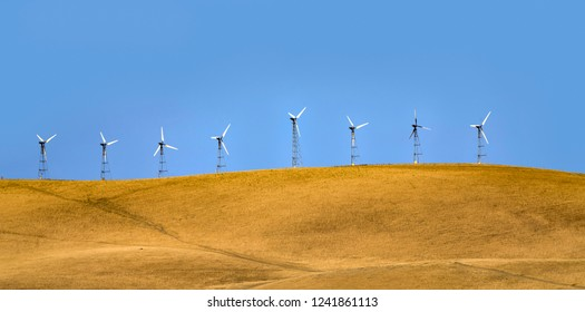 wind generators on the hills of San Francisco under blue sky