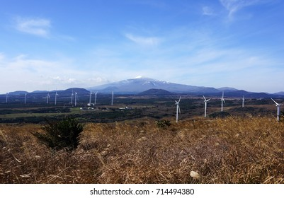 Wind generators on the top of the mountain. Wind turbines on the mountain. Windmills for electric power production on mountain.