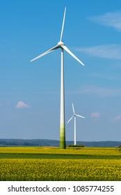 Wind generators in a rapeseed field seen in rural Germany