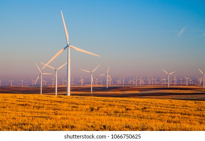 Wind generators in Sherman County Oregon wheat country are shown against a blue sky.    Located a few miles south of the Columbia River Gorge.