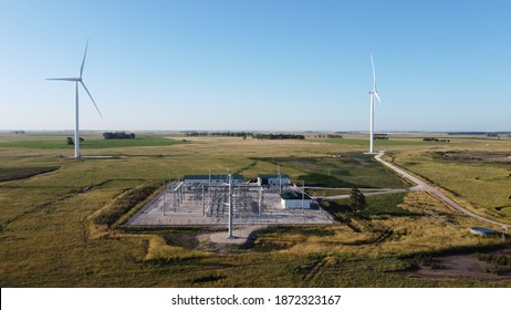 wind generators and substation with a colors sky