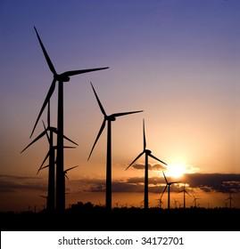 Wind generators at sunset