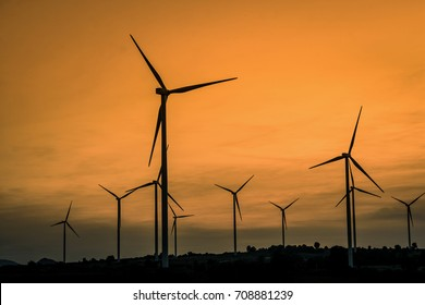 Wind generators turbines at sunset. Beautiful mountain landscape with wind generators turbines at Huai Bong,Dan Khun Thot ,Thailand. Renewable energy concept.