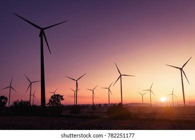 Wind generators turbines at sunset. Beautiful mountain landscape with wind generators turbines at Huai Bong,Dan Khun Thot ,Thailand. Renewable energy concept.