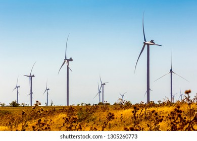 Wind mill in field. Power and energy, electric wind turbine