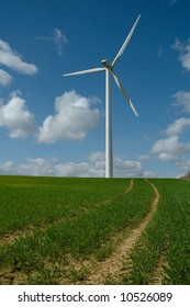 wind mill in a field in spring