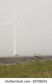 wind mill power station in fog