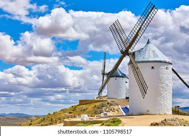 Wind mills at knolls at Consuegra, Toledo region, Castilla La Mancha, Spain. Route of Don Quixote with windmills. Summer landscape with blue sky and clouds.