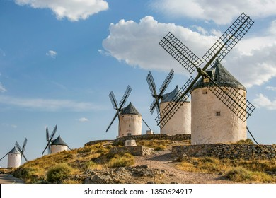 Wind mills at knolls at Consuegra, Toledo region, Castilla La Mancha, Spain. Route of Don Quixote with windmills. Summer landscape with blue sky and clouds