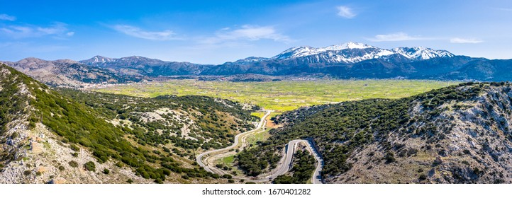 Wind mills on the mountain plateau Lasithi in the inland of the island of Crete, Greece
