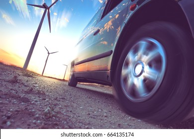 Wind mills and tire car detail.Electricity and ecology. Industry of electric car and renewable energy concept