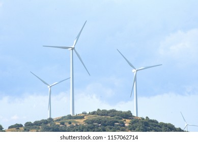Wind mills at the top of a hill
