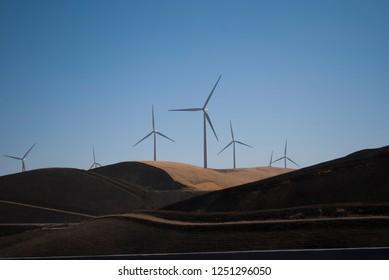 Wind mills working. California hills