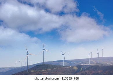 Wind power energy generation plant at the mountain hill