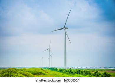 wind power farm in cloudy, renewable electric energy production at chinese coastal.
