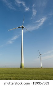 Wind power field with blue sky and white clouds
