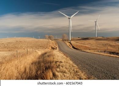 Wind power generating stations in the rural Alberta prairies of Canada.