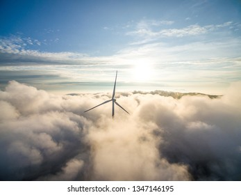 Wind power generator before sunrise sunset,Wind power generation in the sea of clouds