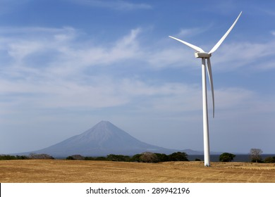 wind power generator in Nicaragua with volcano in the background